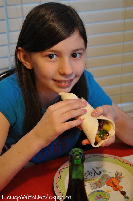 Enjoying Chicken tacos with black bean mango salsa