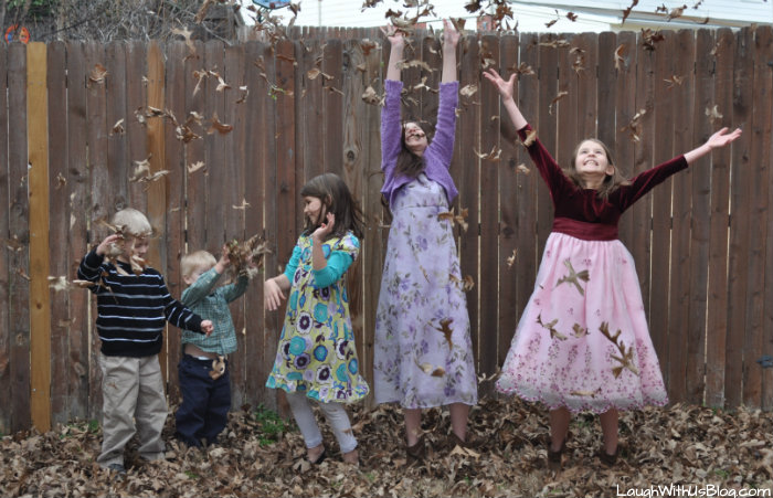 five kids in the leaves
