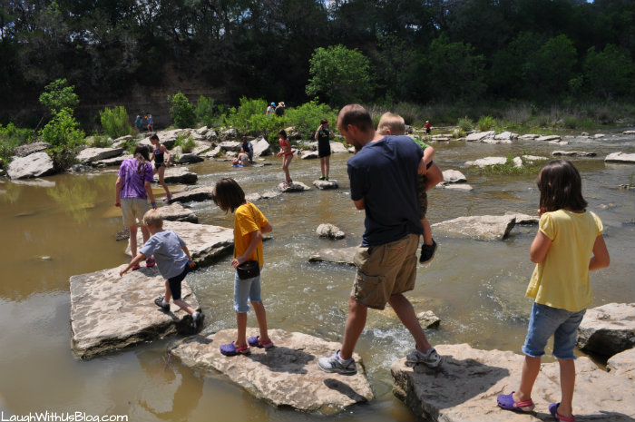 Crossing the river on stones at Dinosaur Valley State Park