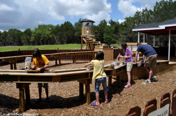 Mining for rocks at Dinosaur World Glen Rose TX #ad