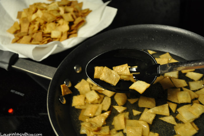 Remove fried tortillas from oil #GoldrichYolk #ad
