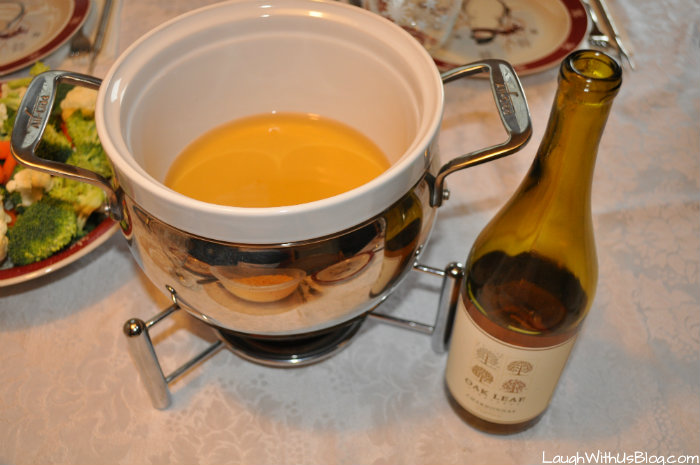 Heat the wine for cheese fondue