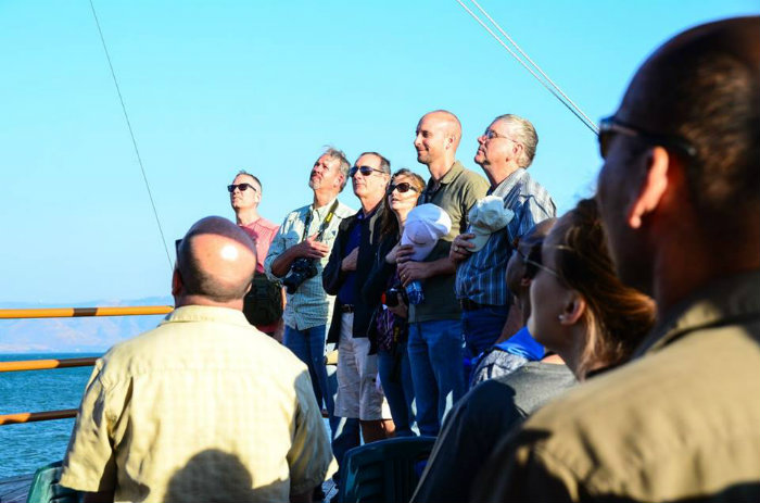 Singing on the boat on the Sea of Galilee