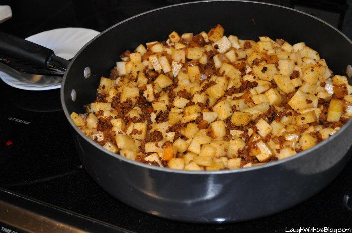 stir chorizo con papas and cook