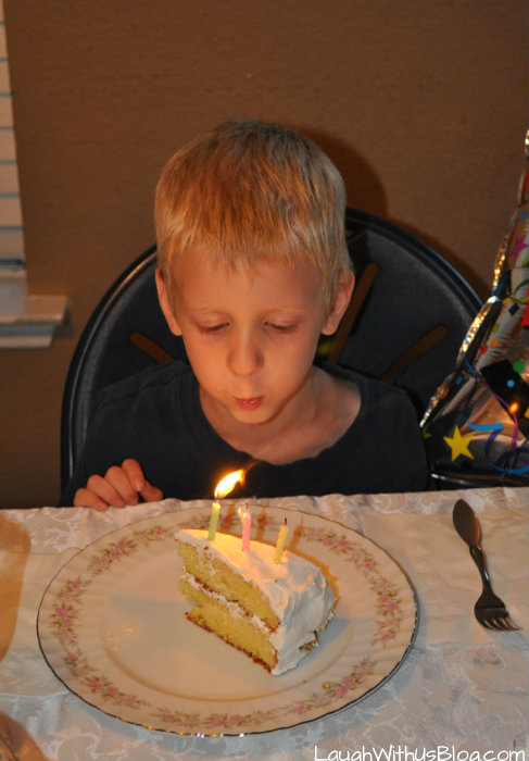 Blowing out candle's 6th birthday